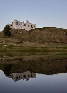 Portrait image of The Kinloch Club Resort building perched on top of a hill