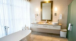 Freestanding bath and contemporary bathroom amenities in a Kinloch Club Junior Suite