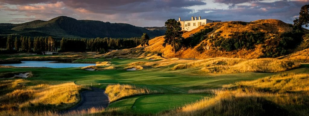 Overlooking the Kinloch Club golf course and main manor with forested hills in background at dusk