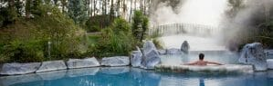 Man bathing in a geothermal pool in the Wairakei Terraces, New Zealand