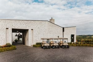 Image of golf carts in front of The Kinloch Club's main entrance, Taupo, New Zealand