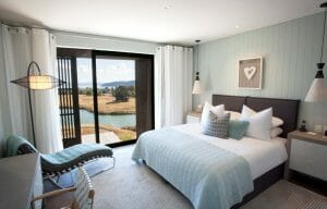 Interior view of a Junior Suite overlooking a lake on The Kinloch Club Golf Course, Taupo