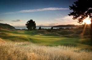 Landscape image of the Kinloch Club golf course's undulating green beneath a setting sun