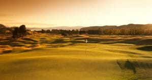 The golden light of dusk drenches The Kinloch Club's undulating golf course with light