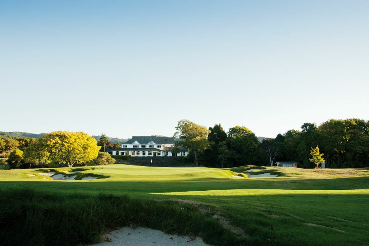 View of the 18th green and clubhouse building at Royal Wellington Golf Club
