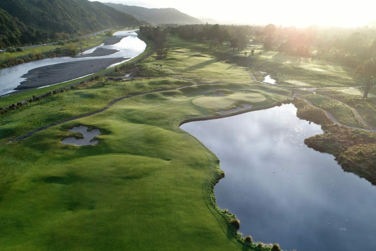 Aerial view over the golf course with an adjacent river at Royal Wellington Golf Club