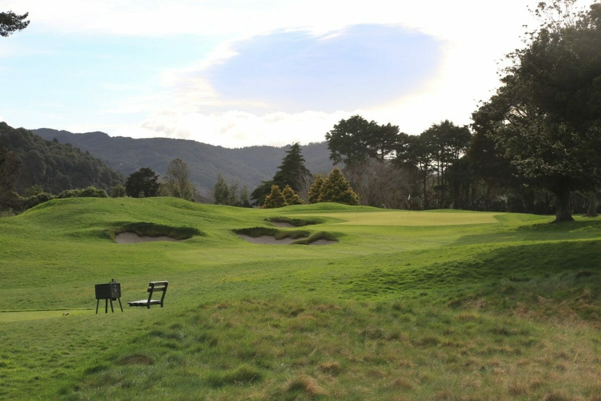 View of a par-3 hole on the Royal Wellington Golf Course with heavily forested hills in the background