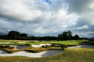 A green is flanked by two large bunkers at Royal Melbourne