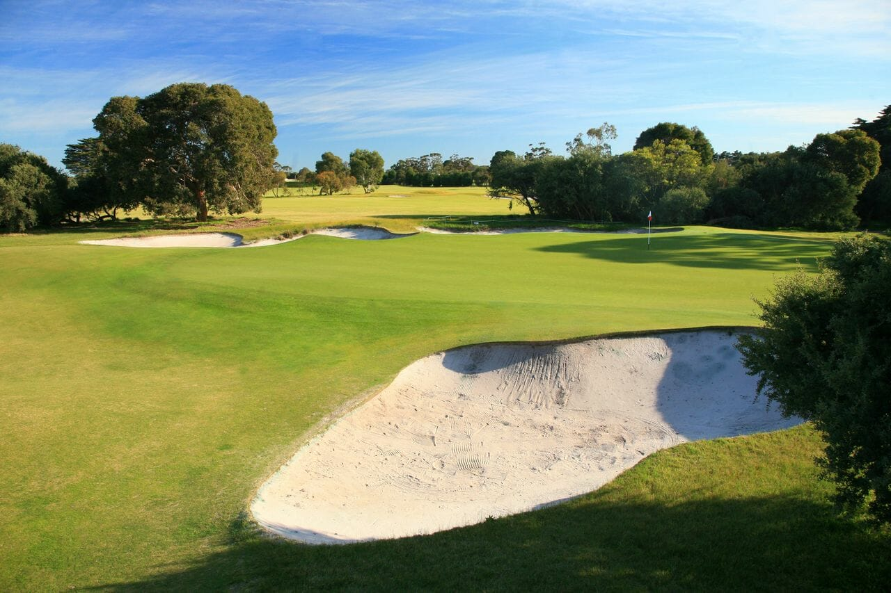 Large sandy bunkers contrast with pure greens at Royal Melbourne Golf Course