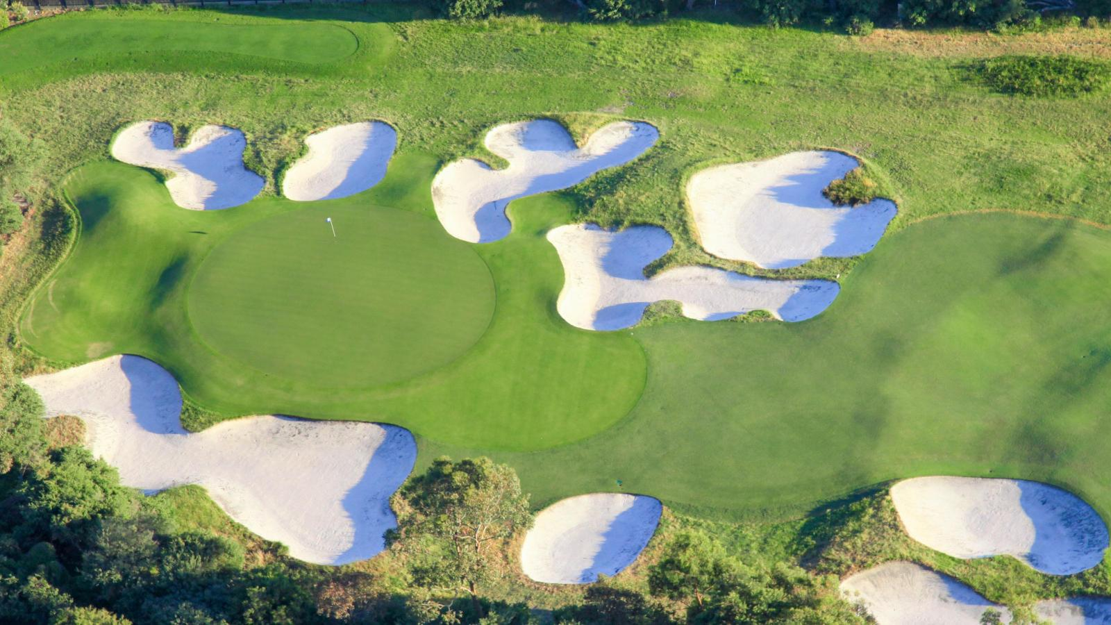 birds-eye-view of numerous bunkers flanking the sixteenth green at Royal Melbourne golf course