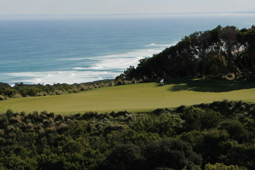 A plateaued green overlooks Bass Strait on The Old Course at The National Golf Club