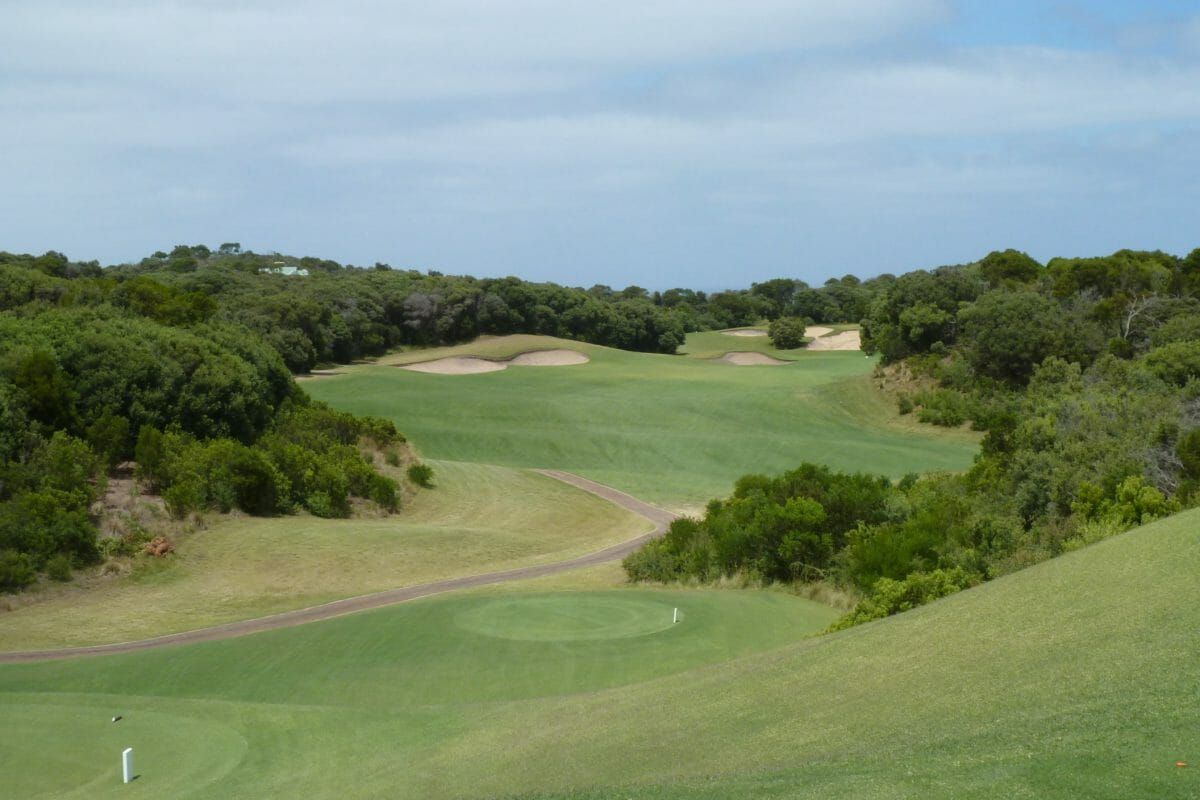 Overlooking the sixth fairway lined with dense foliage