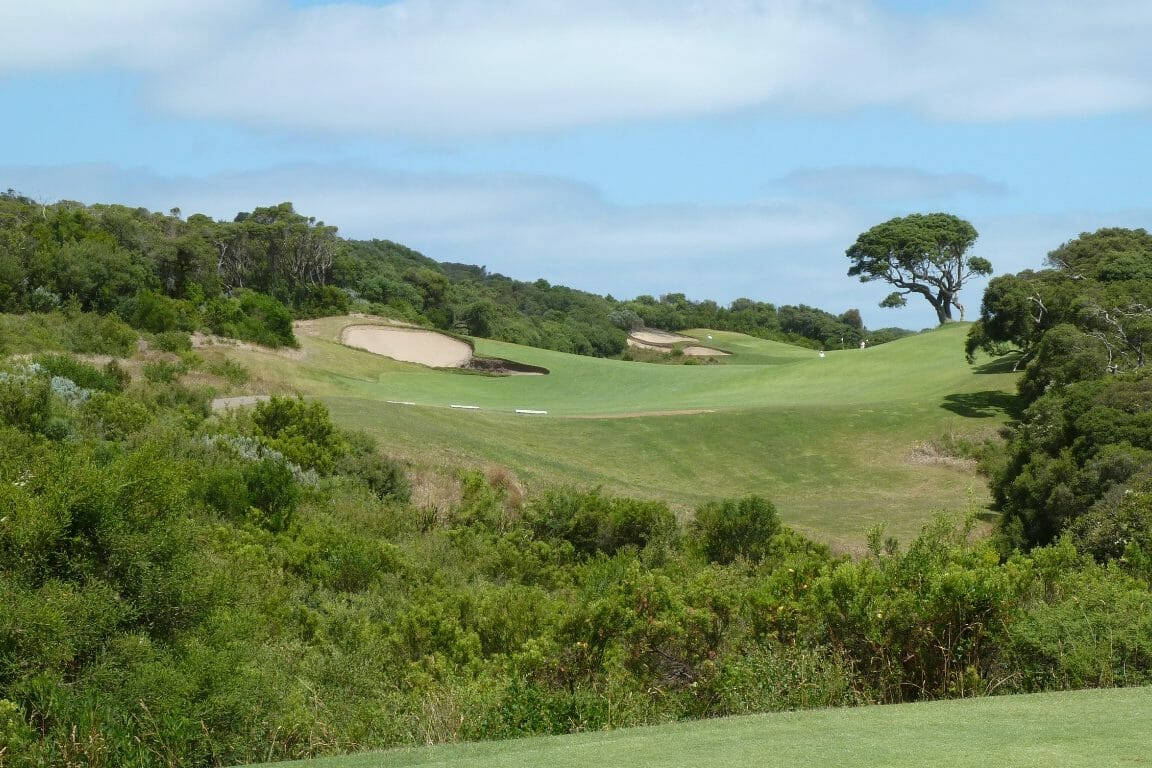 A ravine filled with scrub separates the first tee from the fairway