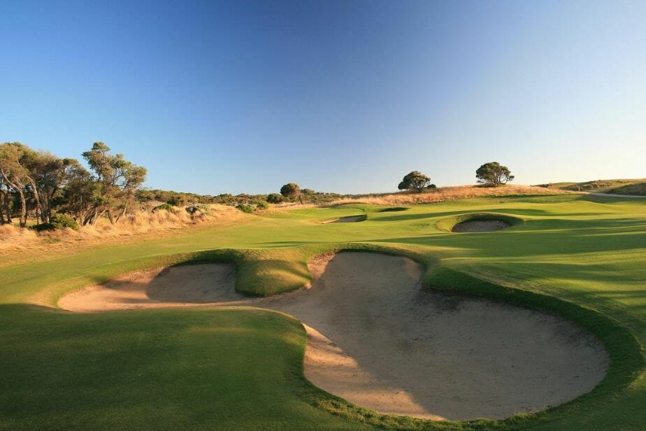 Overlooking large bunkers leading to an uphill green