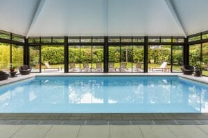 An indoor pool and lounge chairs feature at the Golf du Medoc Resort