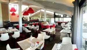 Contemporary clubhouse restaurant with red and white colouring