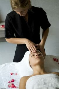 A woman receives a facial treatment at Golf du Medoc Resort