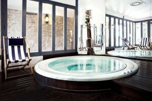Spacious circular indoor jacuzzi is available to staying guests at Golf du Medoc Resort