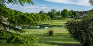 A lake sits adjacent to the eighteenth hole at Chateaux de Vigiers golf course