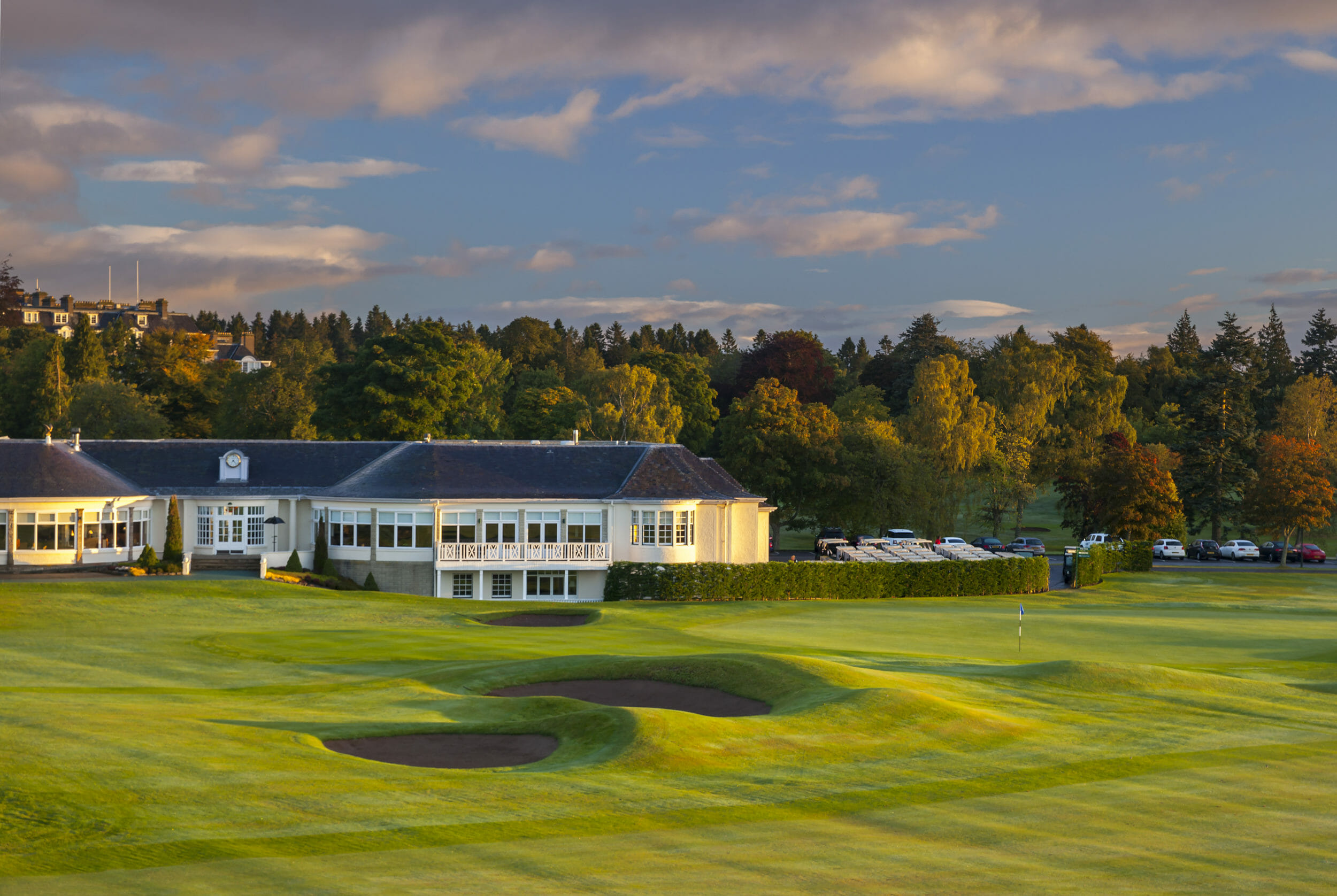 External view of the clubhouse and adjacent Queens Golf Course