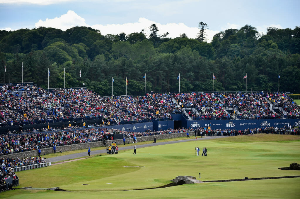 The Swilcan Bridge extends over the course in front of a large crowd at The Open