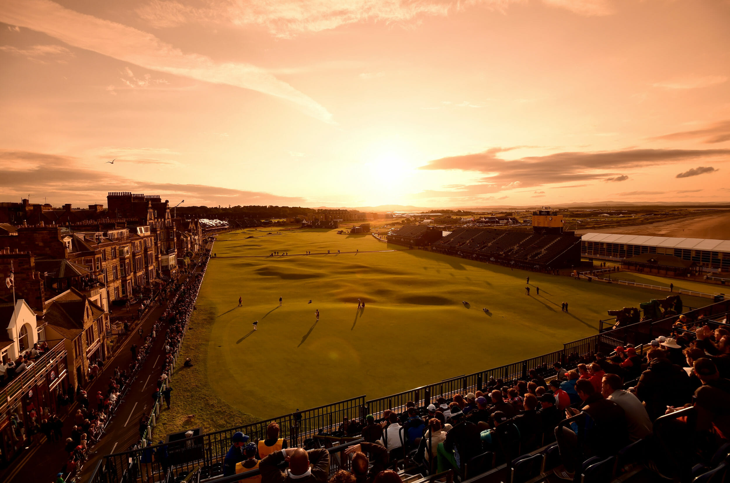 Dawn sun rises over the Old Course at St Andrews Links in Scotland