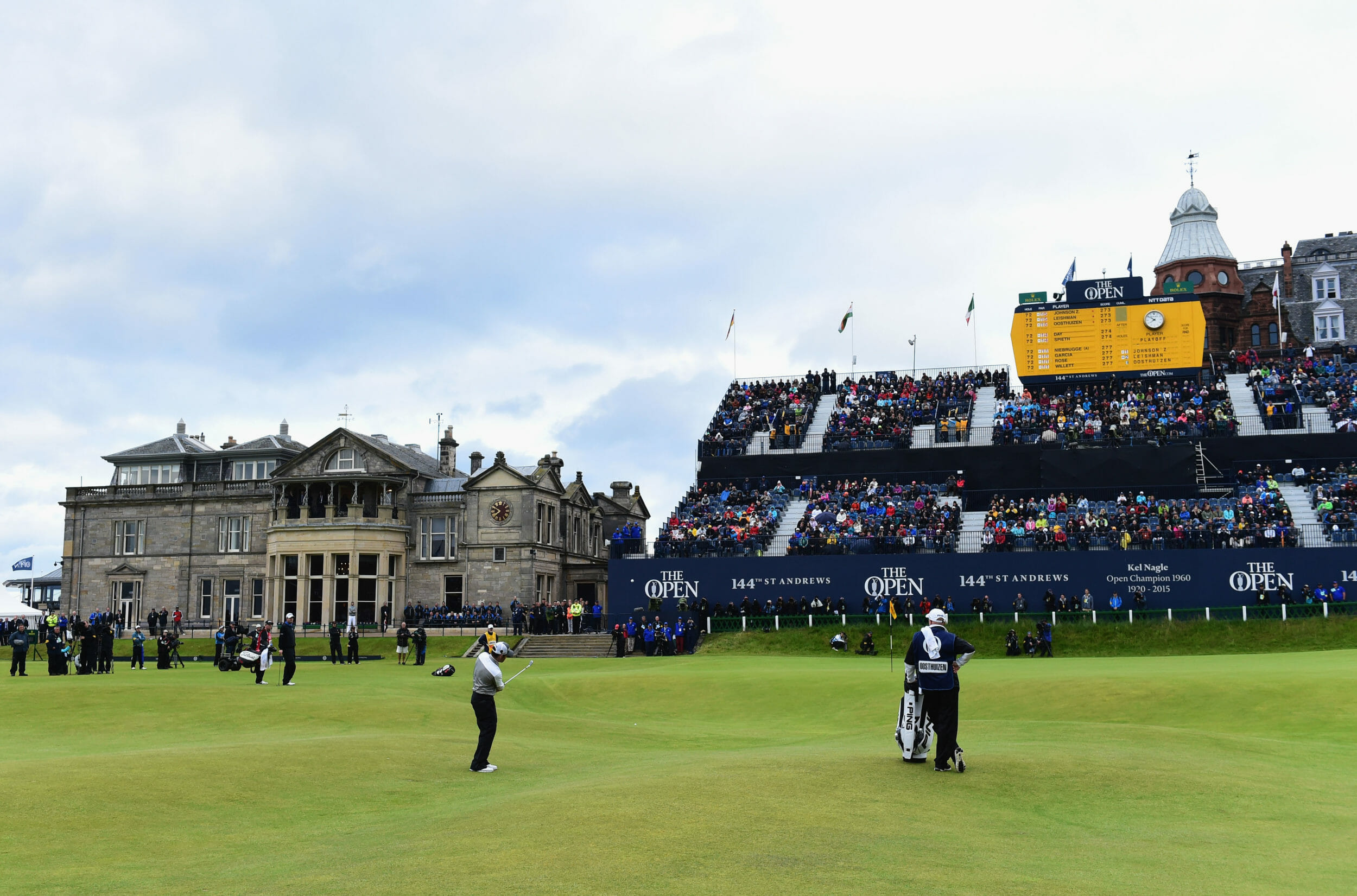Louis Oostheuizen walks on the green in front of a grand stand at The Open