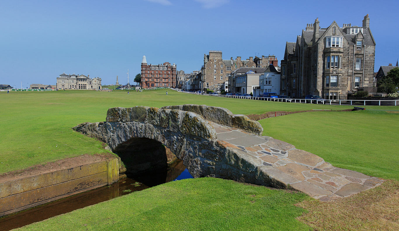Iconic Swilcan Bridge and St Andrews town buildings