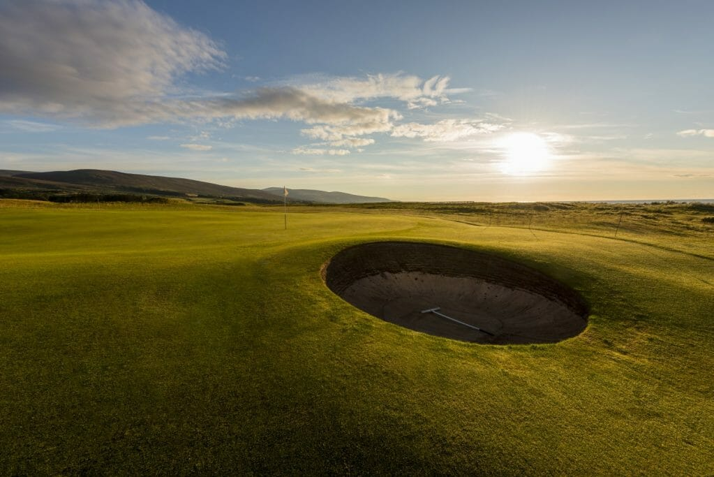 A round pot-bunker protects a green at Brora Golf Club