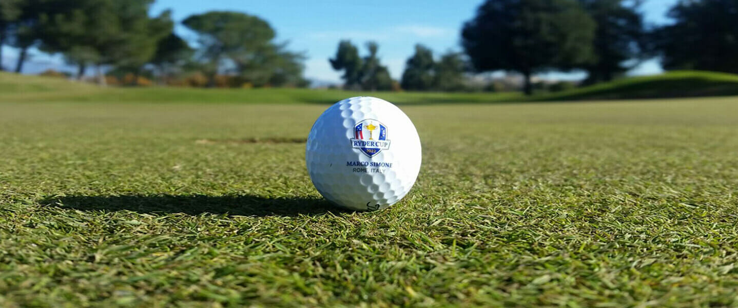 A golf ball branded with the 2022 Ryder Cup logo