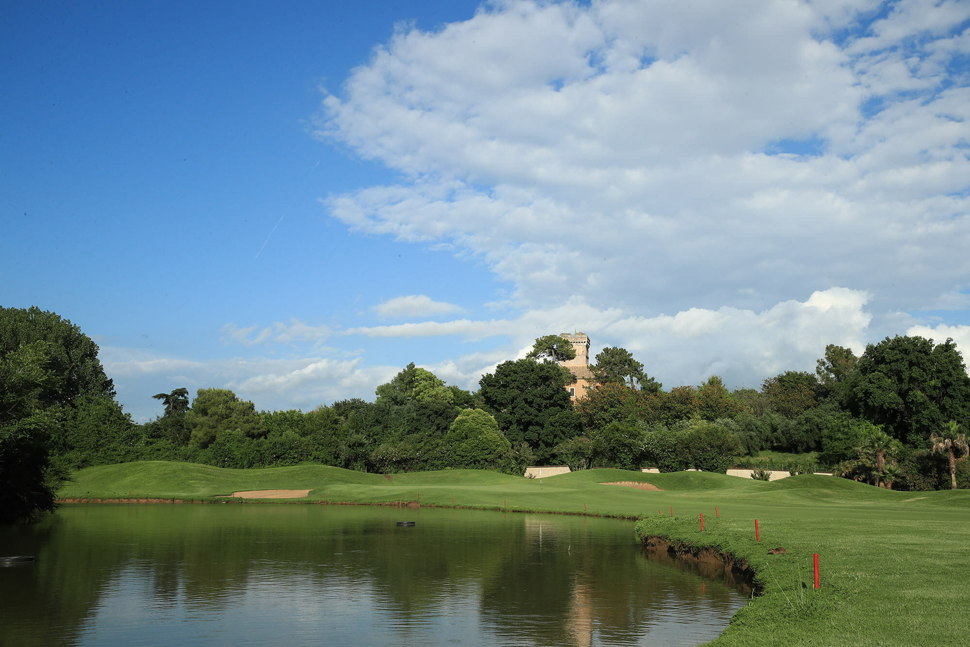 Marco Simone Golf and Country Club course lake and castle