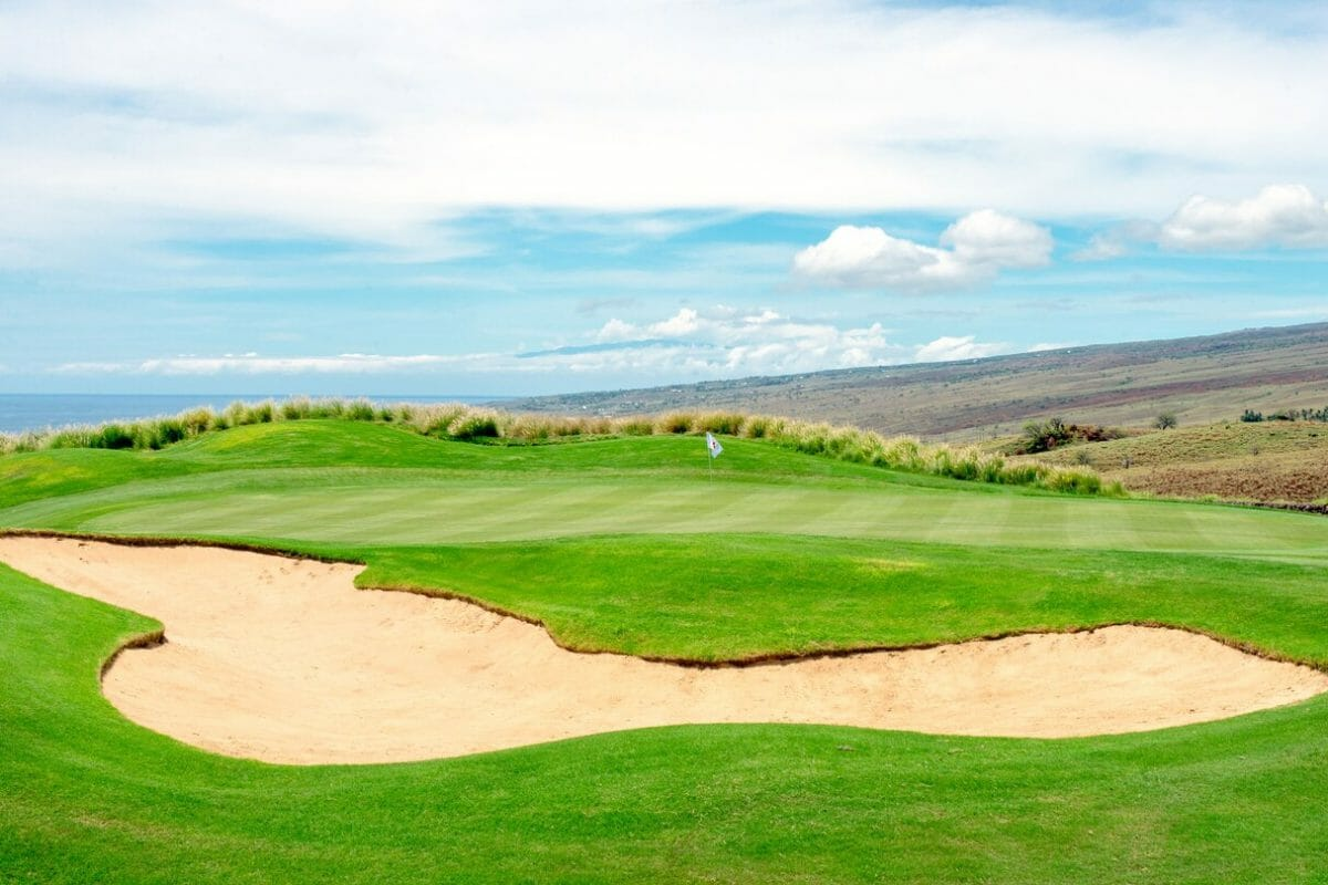 A large bunker protects a raised golf green at Westin Hapuna Beach Resort