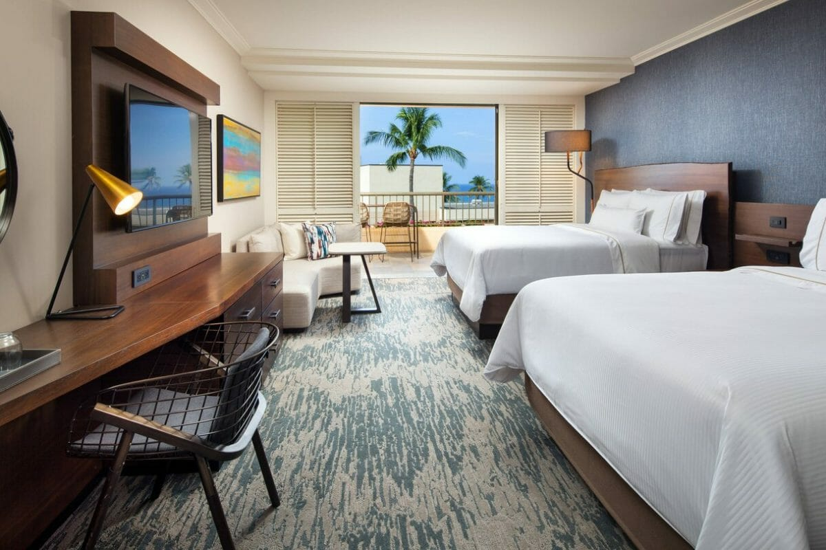Twin beds and contemporary furniture adorn an Oceanview guestroom