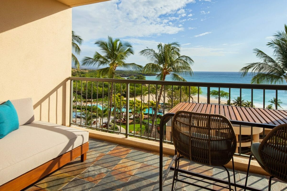 Private balcony on the top floor overlooks the beach and resort pools