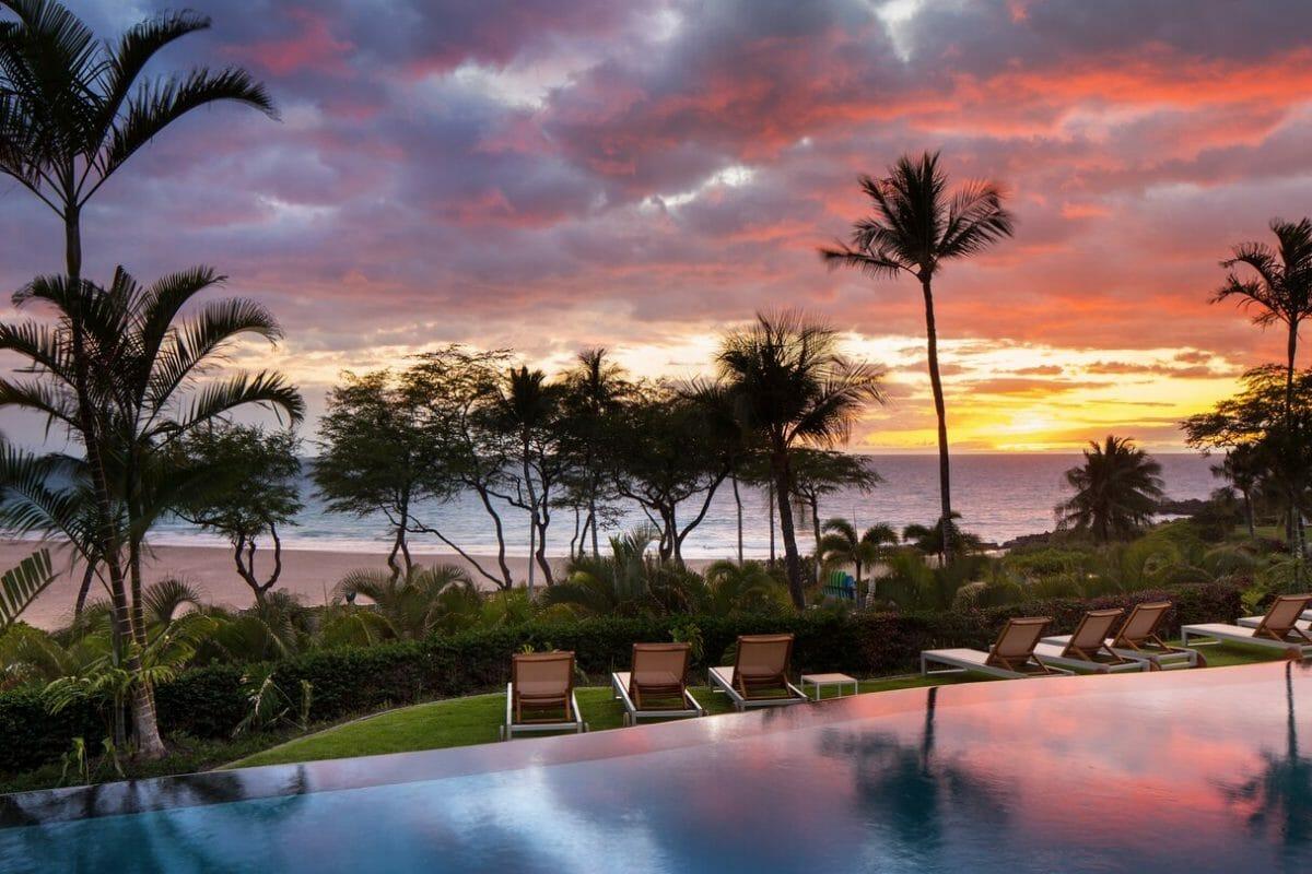 Golden light of the setting sun overlooks an infinity pool at the Westin Hapuna Beach Resort
