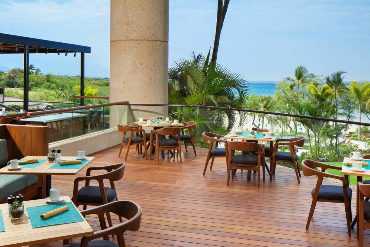 An elevated platform serves as an open-air restaurant at the Westin Hapuna Beach Resort