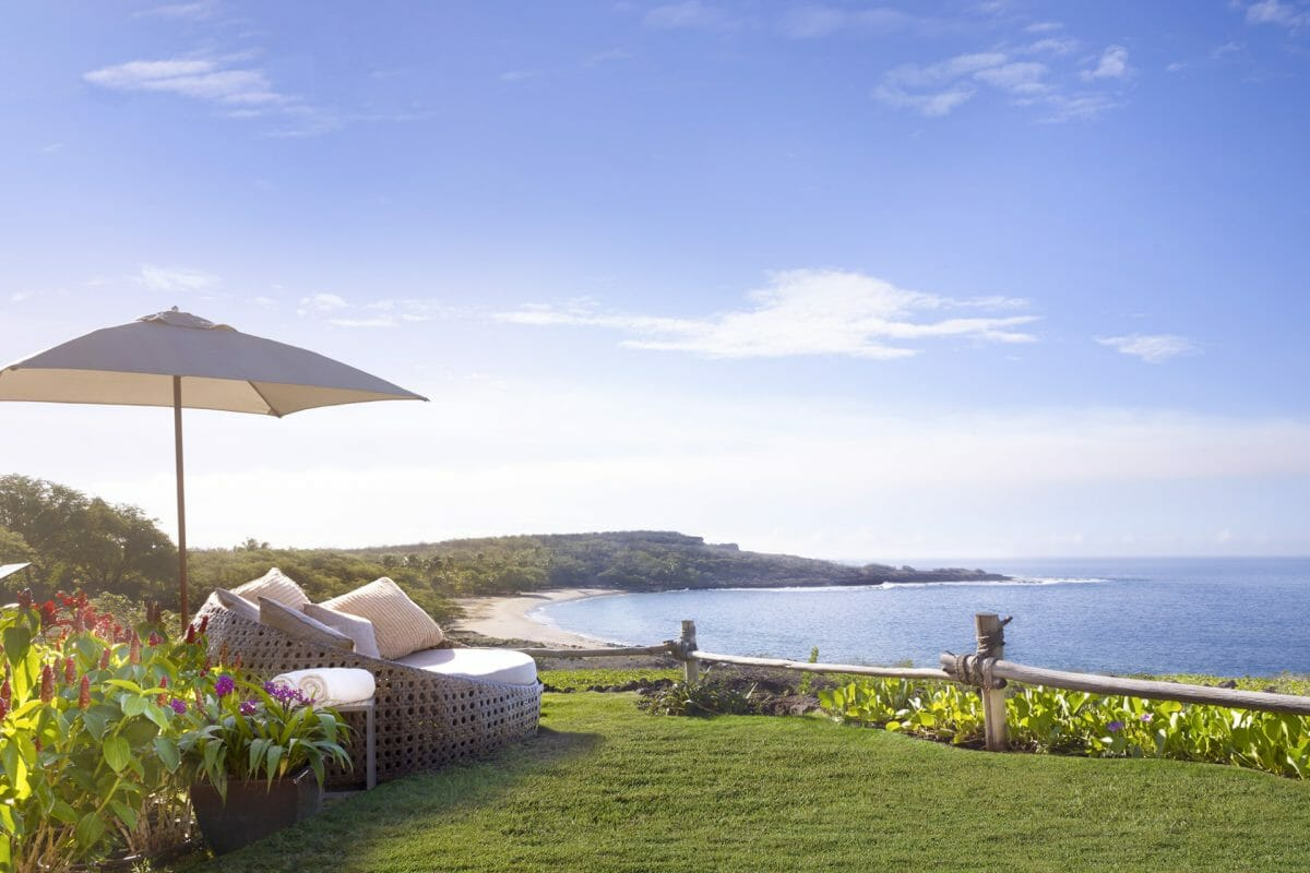 A sun recliner overlooks the Pacific Ocean at Four Seasons Resort