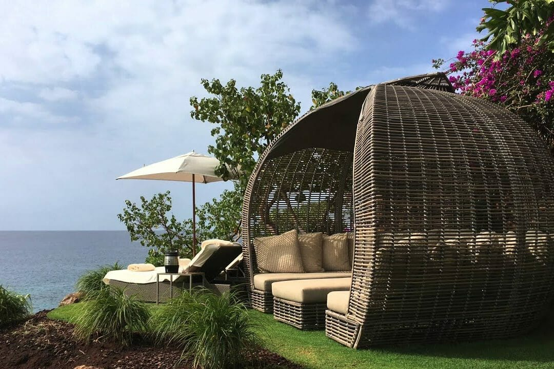 A private cabana allows guests to recline in isolation at Four Seasons Resort