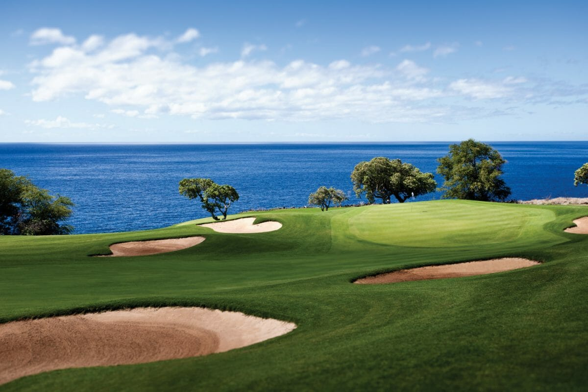 Large bunkers protect the second green with views over the Pacific Ocean