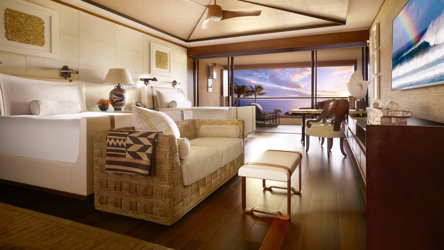 Wooden floors and light decor complete oceanview rooms at Lanai's Four Seasons Resort