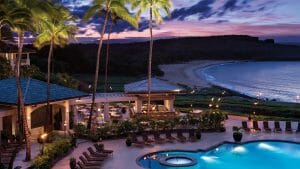 Purple skies shine over a patio dining area at Four Seasons Resort in Lanai