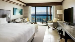 Contemporary living overlooks the Pacific Ocean and distant island of Lanai