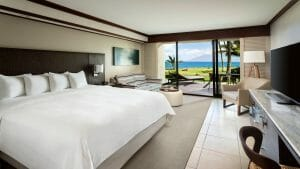 A king bed in an oversized guest room has partial open views and patio
