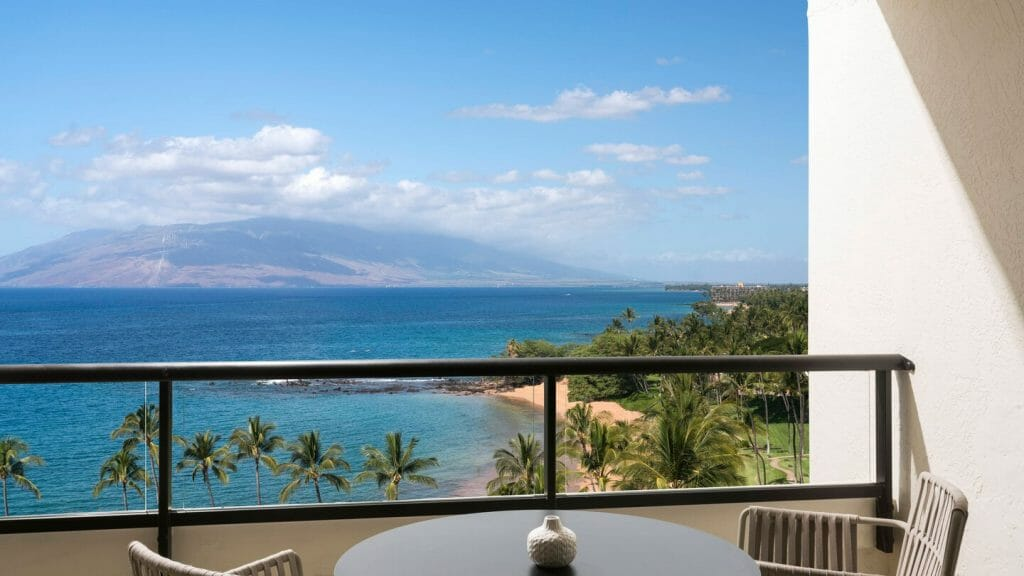 View from a bedroom balcony overlooking the Pacific Ocean and distant island of Lanai