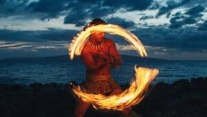 A native Hawaiian dances with fire at a Luau show at Wailea Beach Resort