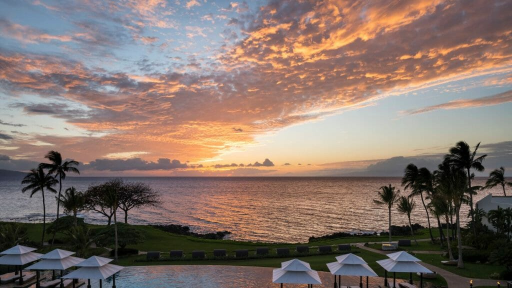 Sunset over the pool and cabanas at Wailea Beach Resort