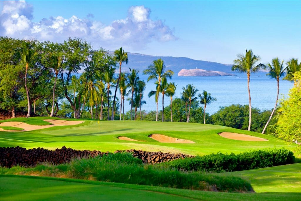 The eighth green is surrounded by large bunkers on the Gold Course at Wailea Beach Resort