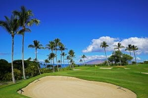 A large bunker overlooks a green and distant Lanai in Hawaii