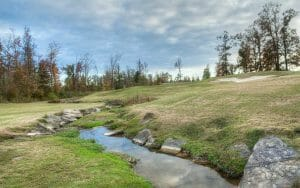 A stream meanders through the eighth hole of the Mindbreaker golf course