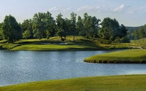 A large lake features on the first hole of the Short course at Silver Lakes